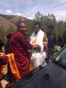 A Tibetan monk offering traditional Tibetan scarf to Sonam Yarphel on his return home.