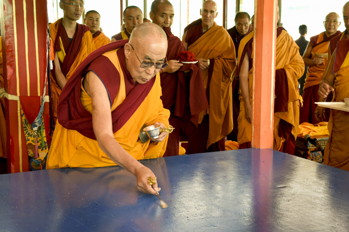His Holiness the Dalai Lama preparing the base for the Kalachakra Sand Mandala that will be constructed by Monks of Namgyal Monastery on the first day of the Kalachakra Teachings in Leh, Ladakh, J&K, India on July 3, 2014. Photo/Manuel Bauer