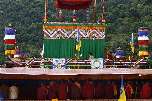 Tibetan monks perform rituals next to a casket where the mortal remains of revered Tibetan Buddhist monk Shamar Rinpoche are kept during his funeral at the Shar Minub monastery near Katmandu, Nepal, Thursday, July 31, 2014. (Photo: Niranjan Shrestha — AP)