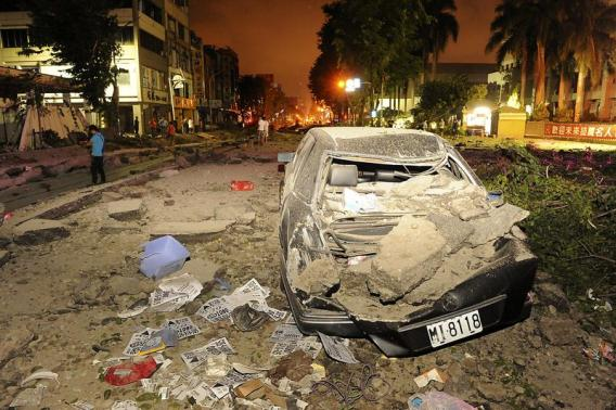 Wreckage of a car is pictured after an explosion in Kaohsiung, southern Taiwan, August 1, 2014. Credit: REUTERS/Stringer