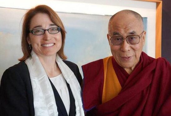 Sarah Sewall and the Dalai Lama.