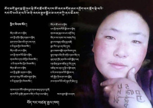 "The original image of Sangay Dolma with ""Tibet is an indepenpent county"" written on her left hand."