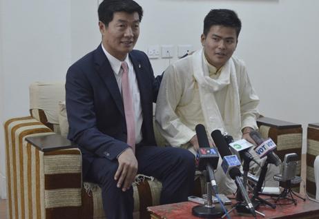 Tenzin Damdul (right) with Sikyong Lobsang Sangay.