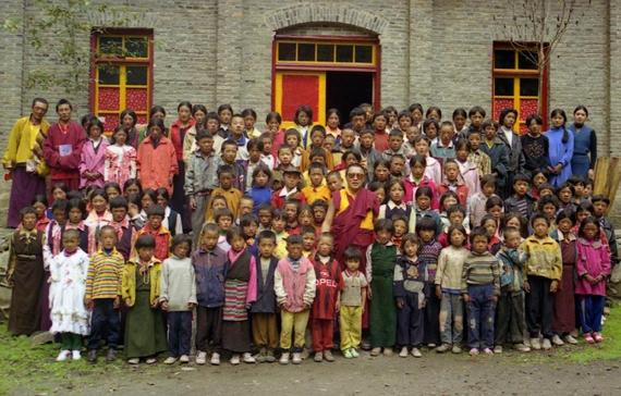 In this photo taken June 1999 and released by Tsering Woeser on July 13, 2015, Tibetan lama Tenzin Delek Rinpoche, center in red robes, poses for photo with orphans at a school in Nyagqu County, also known as Yajiang County in the Garze Tibetan Autonomous Prefecture in southwestern China's Sichuan province.  (Tsering Woeser via AP)