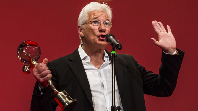 Actor Richard Gere delivers a speech as he receives the Crystal Globe for Outstanding Artistic Contribution to World Cinema at the opening ceremony of the 50th Karlovy Vary International Film Festival (KVIFF) on July 3, 2015 in Karlovy Vary, Czech Republic.  (Photo by Matej Divizna/Getty Images)