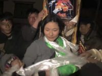 Dolma Tso being offered traditional Tibetan ceremonial scarves by local Tibetans.