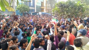 The employees of Oppo waved Indian flags to mark their protest.(HT Photo)