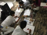Tibetan students paint to observe International Day for Victims of Torture