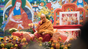 A group of Russina buddhists reciting the Heart Sutra in Russian at the start of His Holiness the Dalai Lama's teaching in Riga, Latvia on September 23, 2017. Photo by Tenzin Choejor