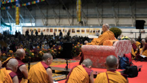 Members of the monastic community sitting on stage with His Holiness the Dalai Lama during his teachings at Skonto Hall in Riga, Latvia on September 23, 2017. Photo by Tenzin Choejor